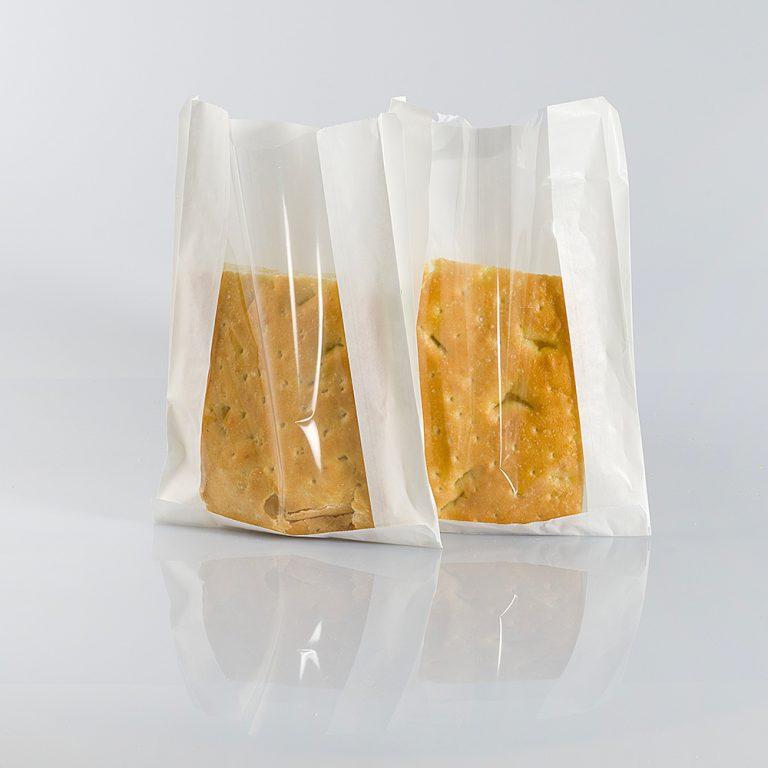 Sacchetto di carta naturale, in pura cellulosa, con finestra. Adatto alla conservazione di alimenti, ideale per prodotti da forno, anche unti